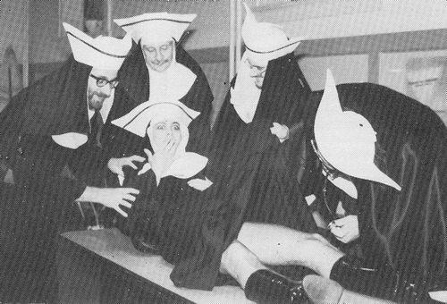 Standing (from left to right): Nurse Sisters Celestial Gates, Sleazia, flogging of Forbidden Fruit, Atrociata von Tasteless. Being inspected: Sister Sadie Masochism Toronto 1980-86